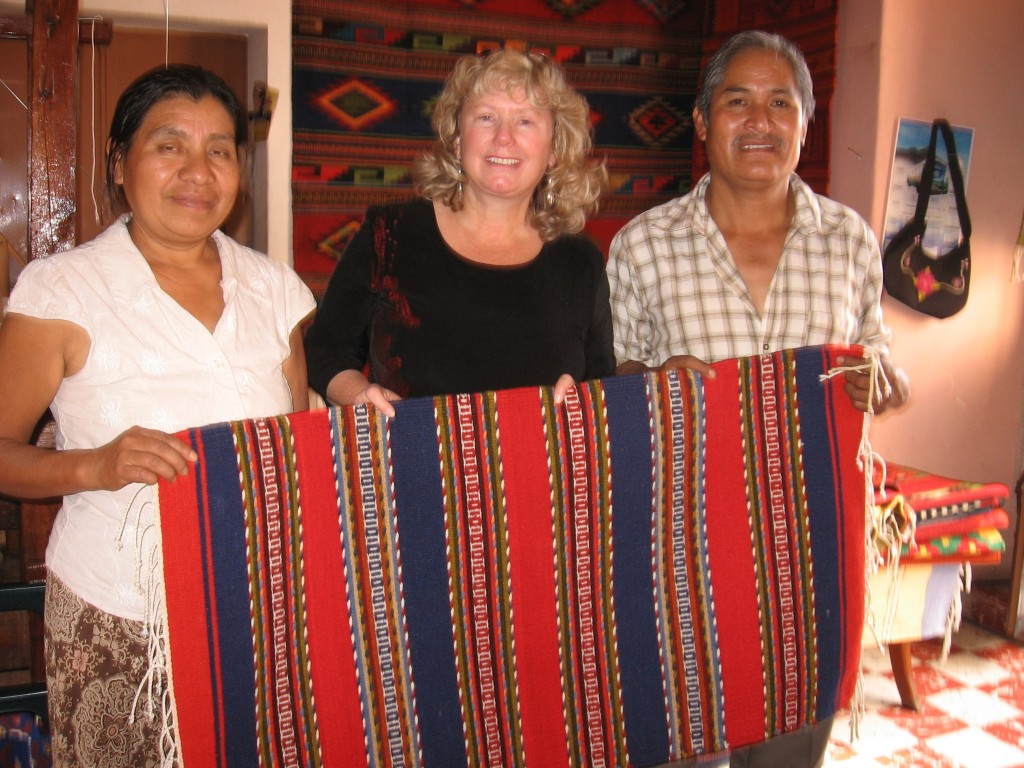 Marian Hubler buys a carpet in Oaxaca.